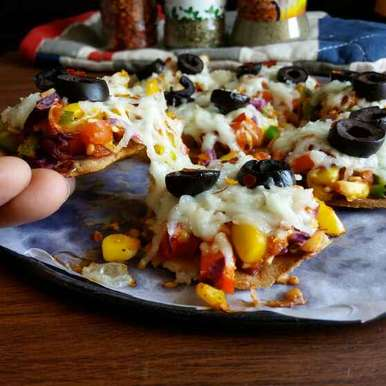 Photo of Baked puri pizza by Dharmistha Kholiya at BetterButter